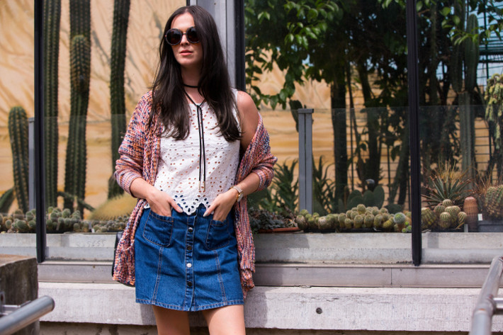 70s style in wrap choker, eyelet top and denim a-line skirt