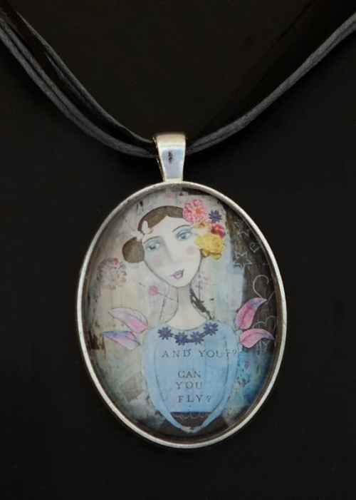art necklace with a print of a portrait