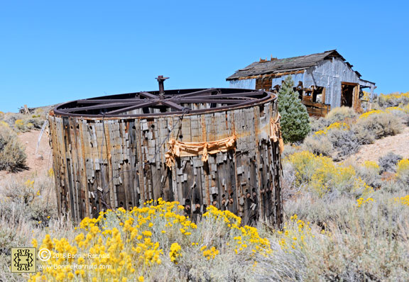 Large drum and tin clad shack, Chemung Mine