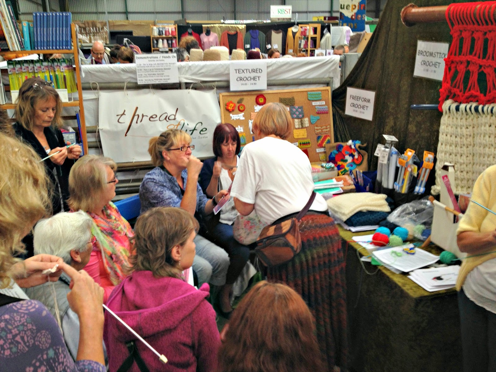 Thread of Life crochet stand at Woolfest demonstrating Tunisian Crochet