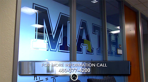 "Snapshot of Math Emporium glass wall with the word ""Math"" etched into it.  Text: For more information, call 480-377-4200"