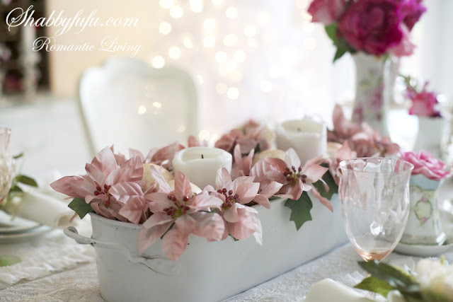 romantic decorating looks for Christmas - blush pink flower centerpiece with white candles