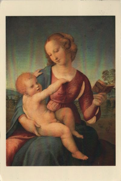 Madonna holding book and child