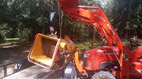 Unloading the WoodMaxx TM-86H wood chipper