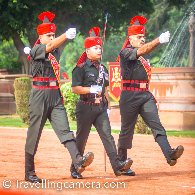 Long time back when started searching about Change of Guards, goolge was suggesting London or Buckinghom Palce. On searching more I got the confirmation that Change of Guards at Indian President's house is open for public on Sturdays. For a long time, the visit remained in plans till I saw the blog by Ruby Singh. So this saturday we planned to visit President's house to witness Change of Guards in morning.     Since the ceremony starts at 8am sharp one needs to plan the day early. All of us were up by 5:30 and started from Noida at 6:30am. It hardly took 30 minutes to reach Rashtrapati House in morning and that gave us enough time to figure out the entry gate and car parking.    We followed the road which connects India Gate to President's house. And when we reached at the entry, police directed us to Dalhousie Road and asked to enter from Gate number 37. When I talked to them, it seemed that no one at entry was very sure. They were sure of one thing that some shooting is happening so entry through gate number 2 is not possible. Anyways we headed to Gate number 37. The security man at Gate number 37 was not sure if entry would happen through this gate. So we requested to confirm so that we head towards the right entry gate. There were 5 more cars following us :). He had few calls and confirmed that entry would happen through gate number 37 and car parking is also available inside. That was a great news because finding parking in this region would be a task (because of security reasons).     As we parked our car, Vibha and I were thinking about the security. No one checked our car and we were already in President's house premises. While we were discussing this, we saw these jawans going towards the ceremony ground. It was a good indication that we should walk fast as it was 7:50 already.      We reached the ceremony and almost all chairs were empty. I headed to the first row and a jawan asked me to move to second row. He mentioned that first row is reserved, while there is no such thing. This is first time I experienced an Armyman cheating in front of me. Anyways, it was not a big deal so I simply moved to second row. By now, only Army band was available at the ceremony ground. And a man was describing about the whole process on loudspeaker.     And then Change of Guard Ceremony started. The Army band started playing 'Saare Jahan se Achha' and these Jawans entered the ceremony ground on their magnificent horses.     At the beginning of the ceremony who see so much disciplined action and feel energetic. There must be a reason why Army ensures that every Jawan is highly disciplined and energetic. Looking at their each action you feel proud.    These horses are amazingly trained. All of them take position and ensure that each one is in row. While standing they hardly do any movement. A few times, you can see some movement around their neck but their legs remain at same position all the time. When we walk, each of them are in sync. I have also seen Beating the Retreat ceremony and was super impressed with camels trained for that ceremony.     Guards already on duty came to foreground of Rashtrapati Bhawan and took their place. Soon after the new set of guards joined them on ground and the formalities started.       All of them were walking with full energy and enthusiasm. Please note the dirt around their feet. All of them were in sync and accurate.       New guards are inspected. It's hard for me to describe each and every ceremony on ground and that's the reason that you should visit Rashtrapati Bhawan on any Saturday to witness the action yourself.     I was super happy to see a Photographer and Videographer who were covering the ceremony. I have never seen Army Photographer earlier and wondering what's the eligibility to become a Photographer with Indian Army :).    The ceremony concluded with some interesting actions by horses. Do check out the video for full action and I found it very interesting.     Some quick details -   Time of Change of Guards - 8 am sharp  When should one reach - By 7:30am (Reason behind this time is explained above) Nearest Metro Station to Indian President's House - Central Secretariat Car Parking around President's House - If entering from Gate-37, parking is available inside. If entering from main gate (Gate no 2, you need to park near water fountains - As per traffic police, it's allowed in morning although I was not very sure ) . Otherwise you can on the road connecting President's House with India Gate.  Entry Ticket for Change of Guards - No ticket or special permission needed Documents to carry - Any valid identity proof in original form.     Mom and dad moving back towards the car after witnessing Change of Guard.     Selfidow or something else. Some creative suggesstions are welcome.    These carved elephants caught my attention and thought of taking a quick shot. The President House has very beautiful carvings all around.     While we were heading towards the car parking we noticed these folks taking some rest in shade. This was the troop, which gave charge to the new team.     This is how Delhi roads look on weekend morning :)  How here is a quiz for you - Which of these photographs are clicked with DSLR and Mobile Camera? Do answer through comment below (And you have to judge through visuals only). The one who answers correctly would get something interesting from Travellingcamera.com Team !!!