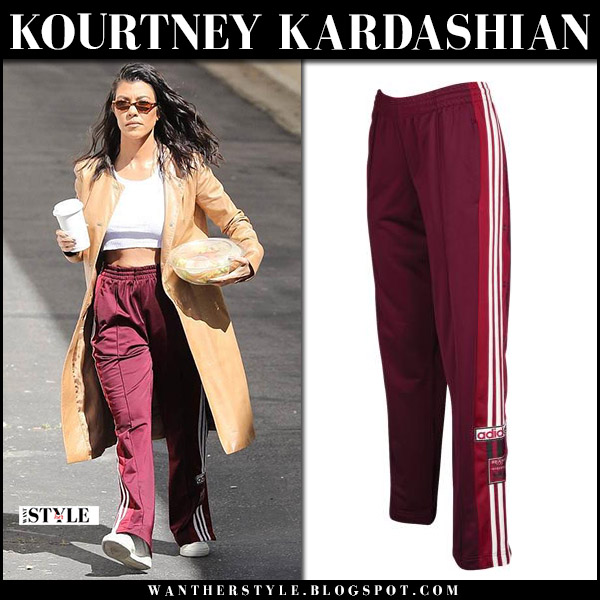 Kourtney Kardashian in burgundy track pants adidas and camel coat street style april 10