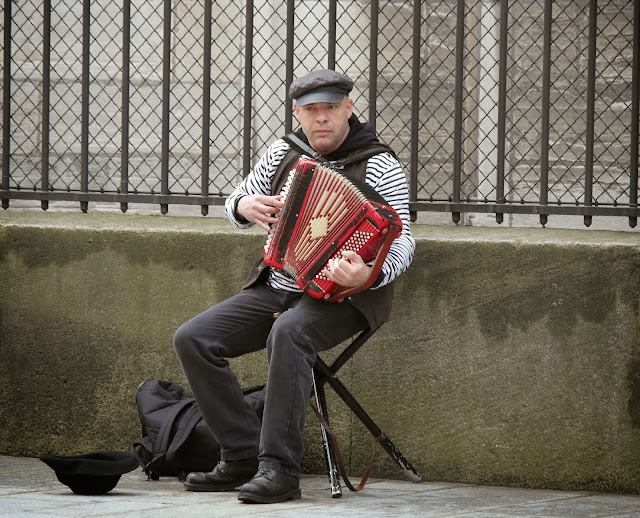 Paris busker musician accordian player