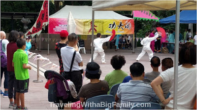 Seeing the Kung Fu show in Kowloon Park with a big family in Hong Kong