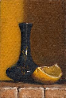 Oil painting of a small blue porcelain vase beside a lemon quarter.