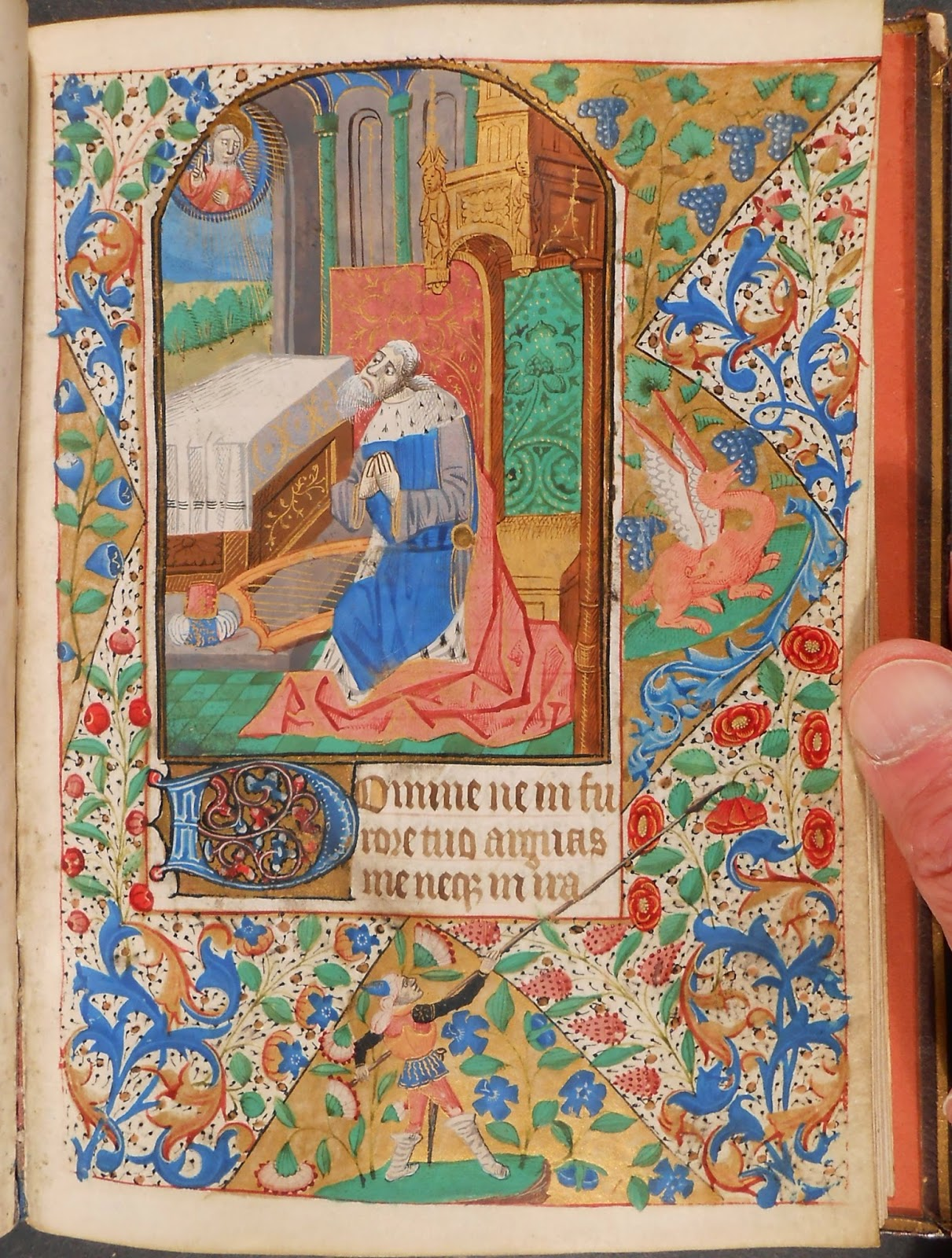A heavily decorated page from a book of hours.