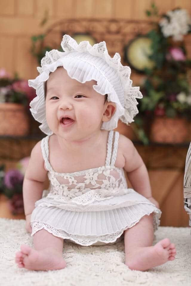 Baby in White Dress With White Headdress HD Copyright Free Image