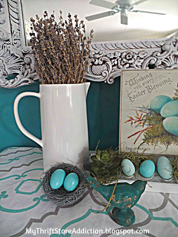 Vintage chicken feeder repurposed for spring mantel