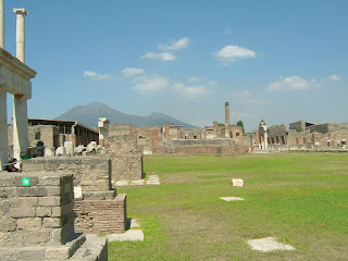 The ruins of the forum at Pompei with a now dormant Vesuvius visible in the distance