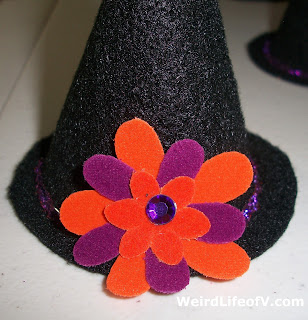 Finished hat with orange and purple felt flower