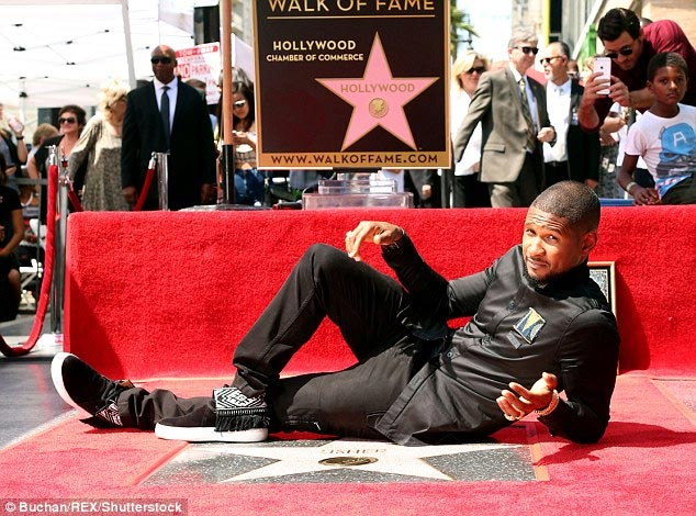 Usher Raymond etches his name in time as star gets Walk Of Fame