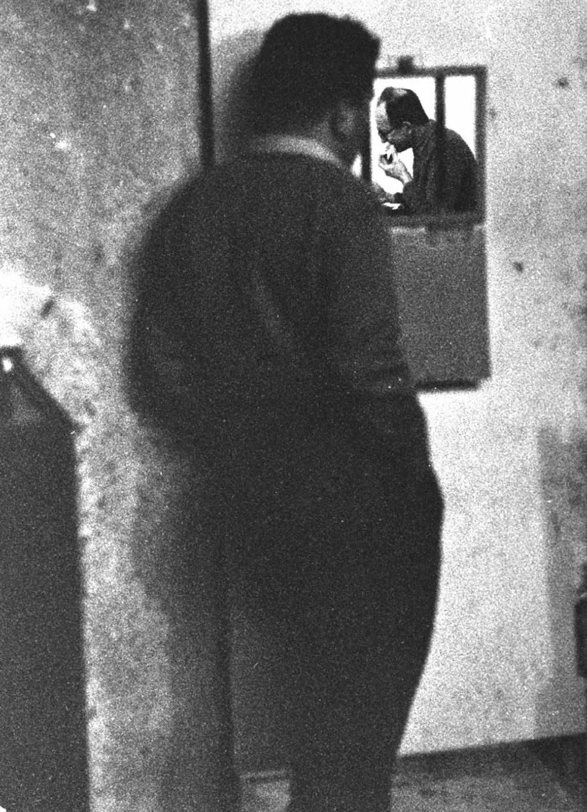 Eichmann ate alone, but watched from outside. Most of the guards did not speak any German, and all were forbidden to talk with him.