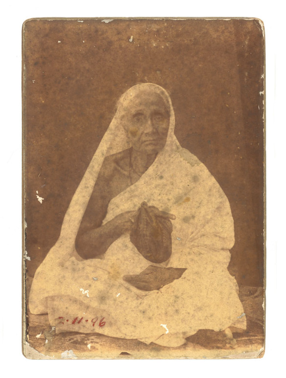 Indian Elderly Woman with a bag of Counting Prayers