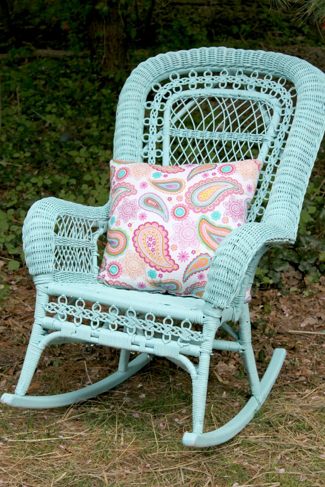spray painted blue wicker chair