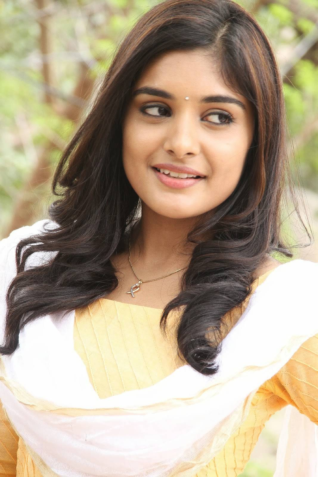 Niveda Thomas Smiling Photos In Yellow Dress