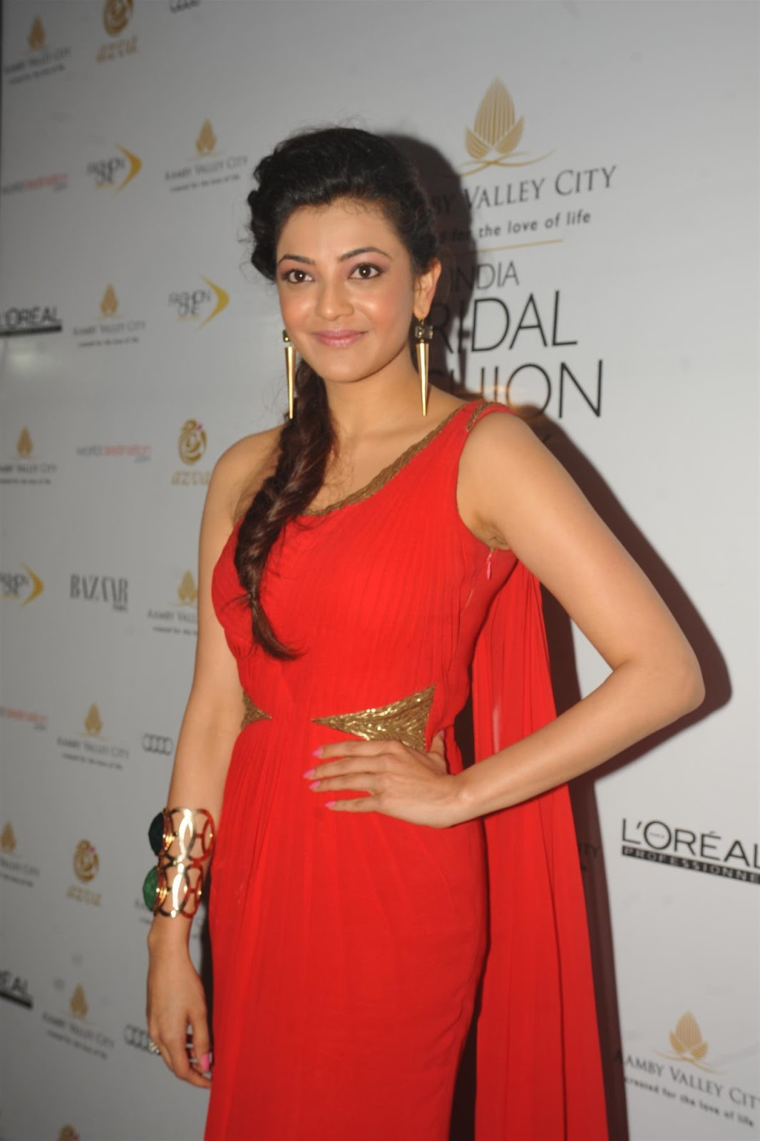 Kajal Agarwal New Stills In Orange Dress