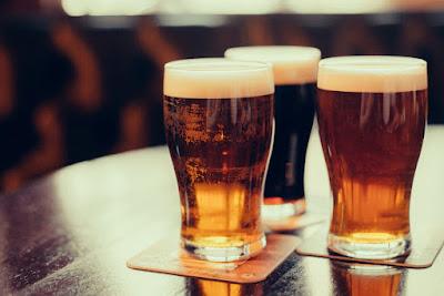 Three beers on counter in Reykjavik bar