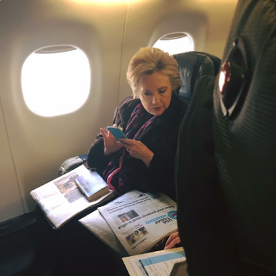 Photo of Hillary Clinton reading about Mike Pence using a private email account has gone viral