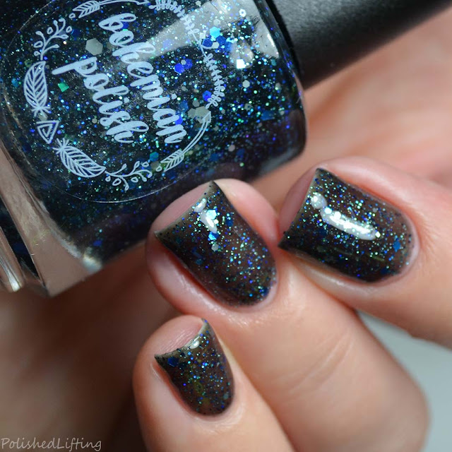 black jelly polish with blue glitter