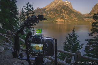 Cramer Imaging's photograph of a camera on a tripod taking a lake picture at Grand Teton National Park Utah at sunrise