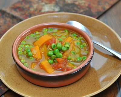 East African Pea Soup ♥ AVeggieVenture.com, a great bowl of spicy vegan soup, just sweet potato, frozen peas and pantry spices.