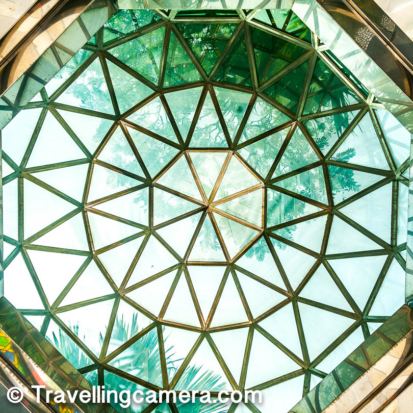 Whole space is beautiful done at National Mosque in Kuala Lumpur. Above photograph shows roof of a six pillared structure in the green park on the outer side of this mosque. These are green trees all around this place and hence this transparent glass has green tint.