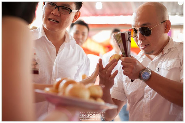 eating pastries filled with goody, holding a paper fan