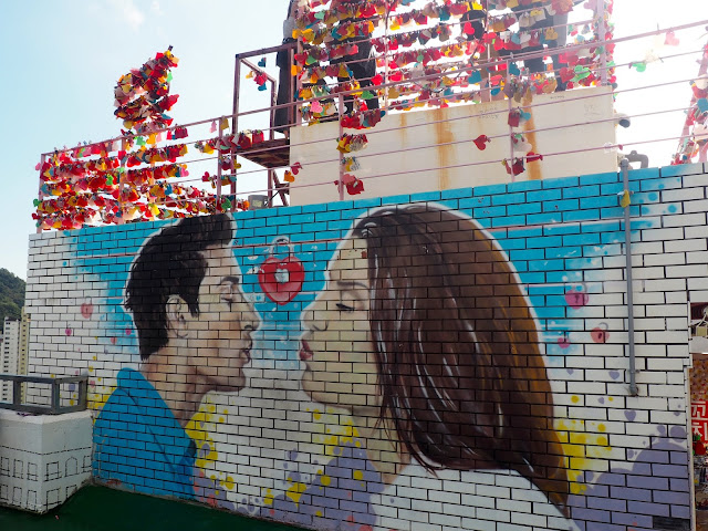 Love locks site and romantic mural in Gamcheon Village, Busan, South Korea