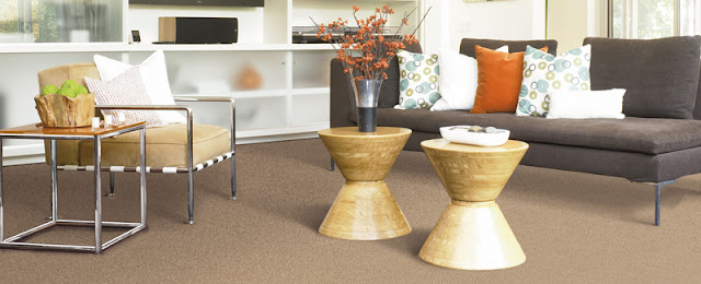 Tan carpet is a neutral background for this modern living space