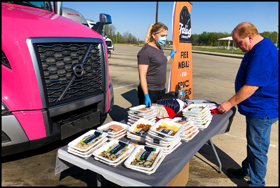 Drivers picking up free meals courtesy of CDL Life and Volvo Trucks North America