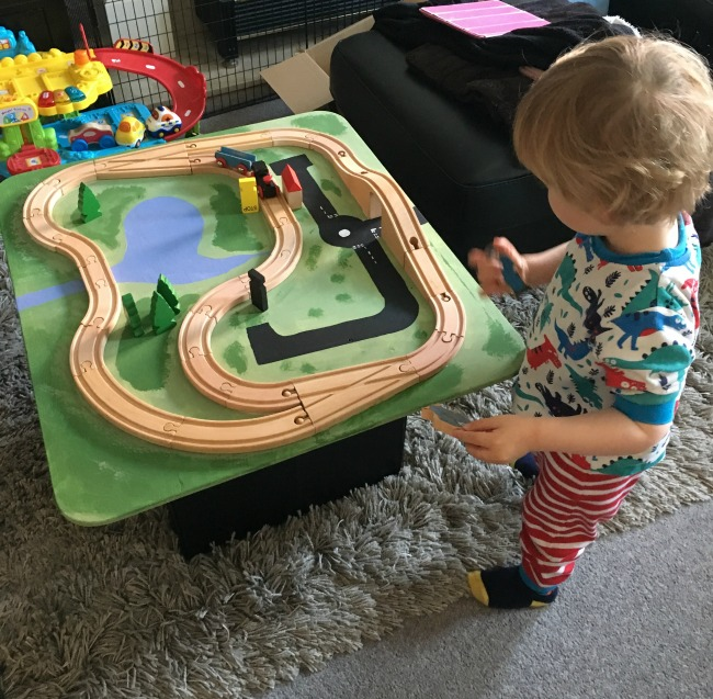 toddler-playing-with-wooden-toy-train