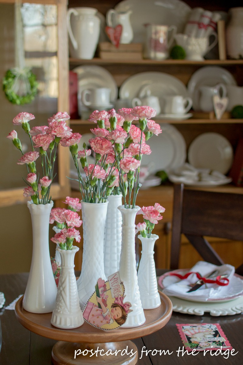A dozen different flower container ideas postcards from the ridge vintage milk glass vases with carnations make a simple pretty centerpiece postcards from the reviewsmspy