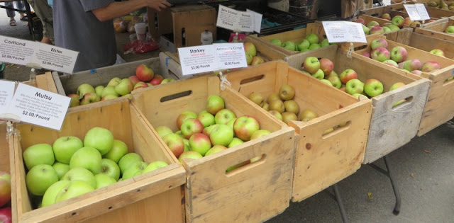 Apples in wooden bins