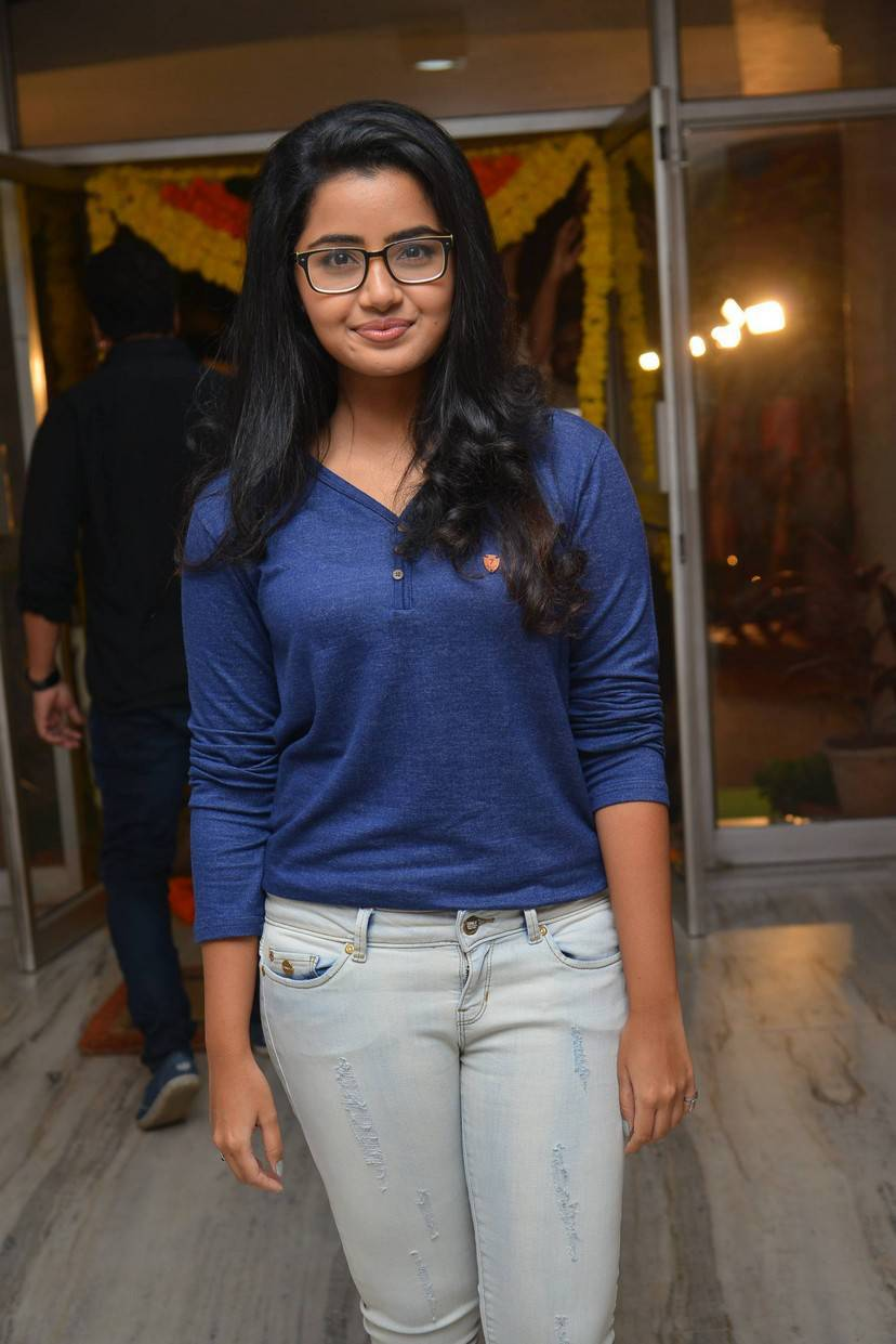 Actress Anupama Stills Whit Glass In Blue Top Jeans