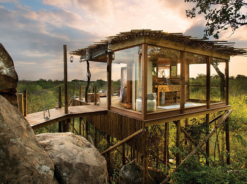 14 Crazy Hotels That Will Give You Serious Travel Goals - The Kingston Treehouse in Lion Sands, South Africa is basically a luxury treehouse, keeping guests away form wildlife while giving them spectacular views.