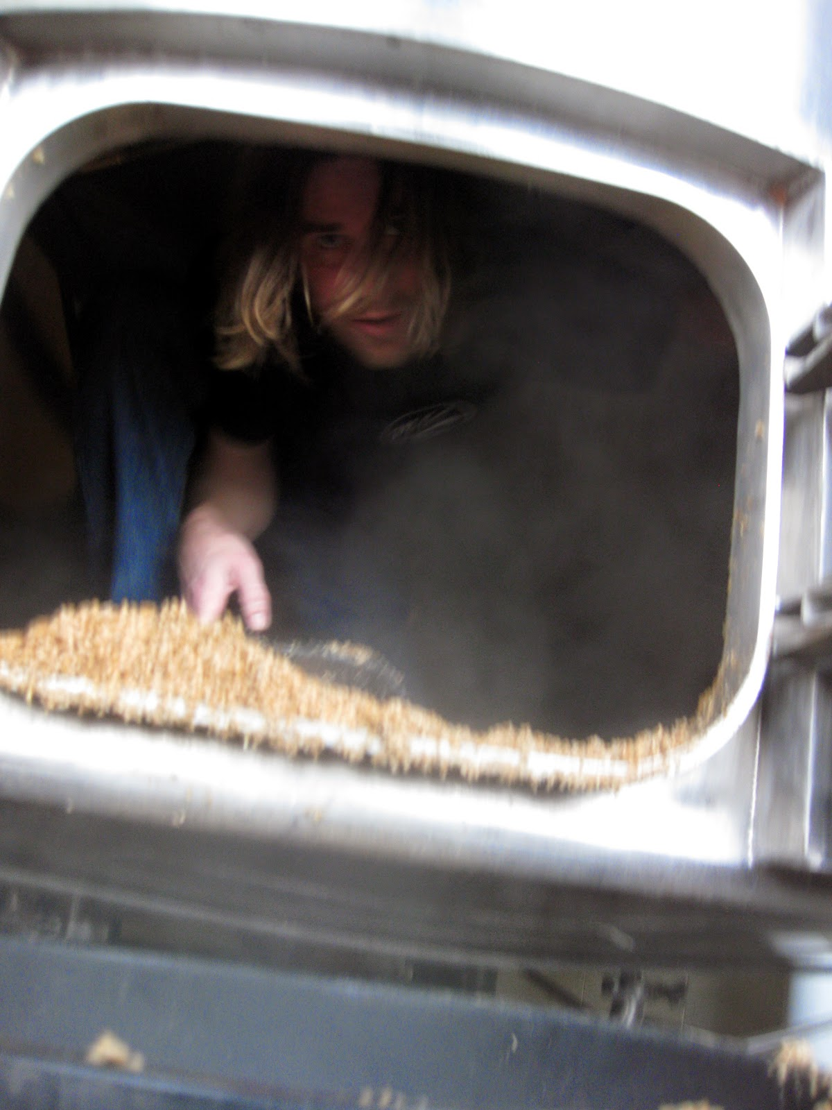 Ryan Michaels in the mash tun at McKenzie Brew House.