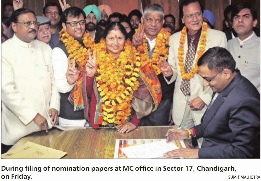 During filing of nomination papers at MC office in Sector 17, Chandigarh on Friday. Alongwith Ex-MP Satya Pal Jain & other