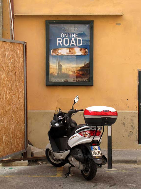 Scooter parked outside the Kino Dessé, Livorno