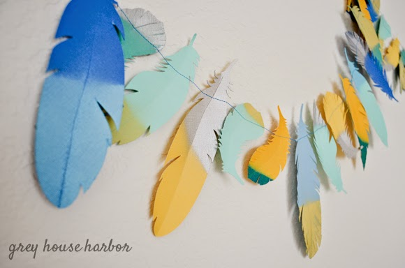 A brightly coloured feathered garland.