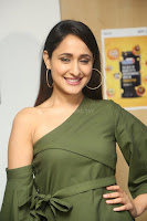 Pragya Jaiswal in a single Sleeves Off Shoulder Green Top Black Leggings promoting JJN Movie at Radio City 10.08.2017 099.JPG