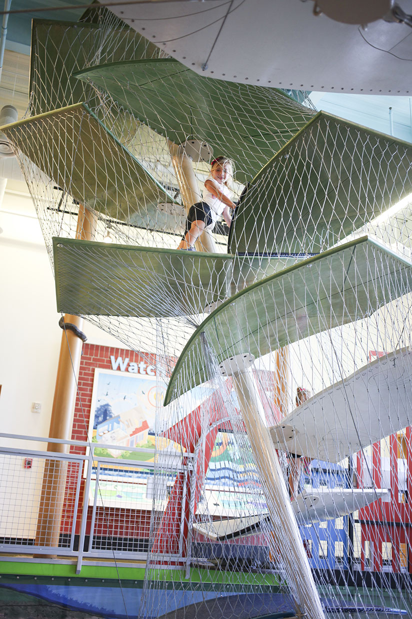 Little girl climbs on a structure at Glazer Children's Museum in Tampa