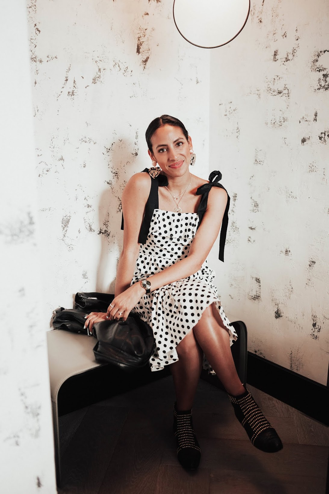 polka dot bow dress, Riad label dress, new dress line, Coach Moto Jacket, Anine Bing Booties, BaubleBar Gigi Resin Heart earrings, Hotel G penthouse suite, Fall style, transitional fall style