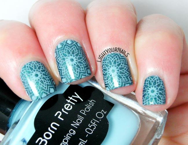 Turquoise kaleidoscope nail art