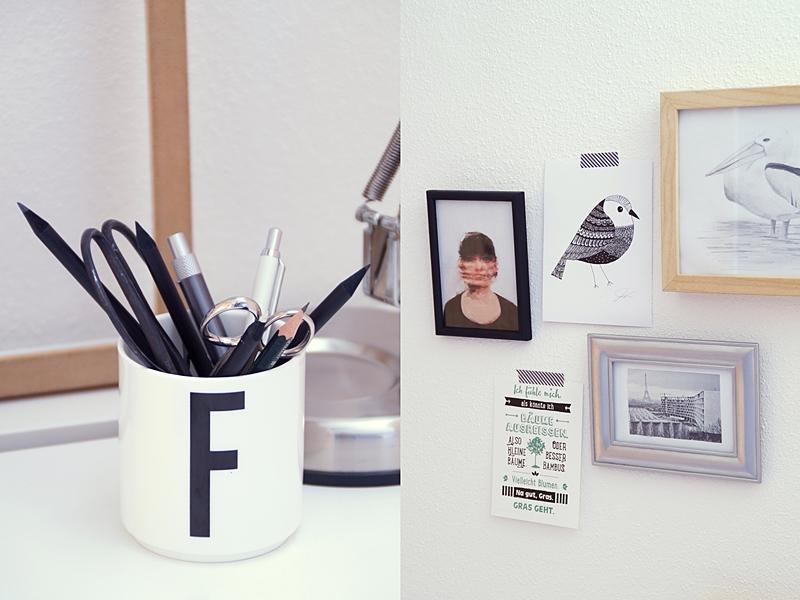 Schreibtisch dekorieren mit Bilderwand und Accessoires in Schwarz/ Weiß/ Naturtönen