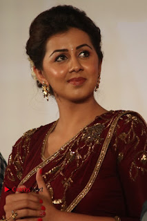 South Indian Actress Nikki Galrani Stills in Red Designer Saree at Maragadha Naanayam Tamil Movie Audio Launch  0008.jpg