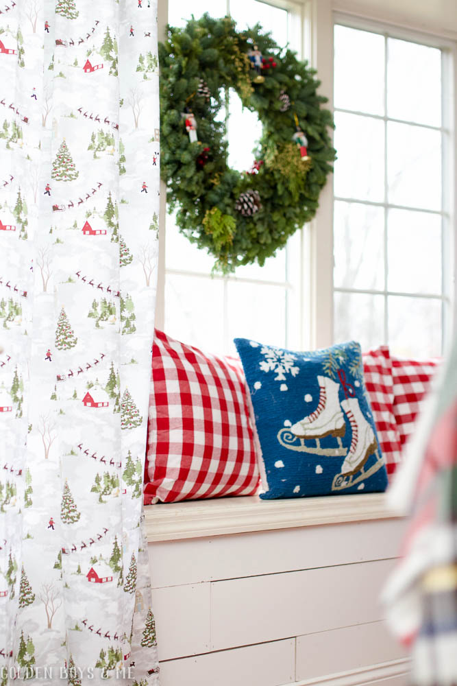 Tablecloth with winter village used as curtains with Christmas window seat